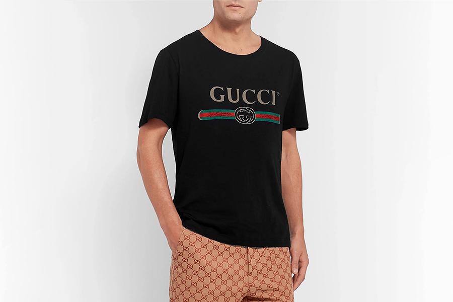 GUCCI Distressed Logo-Print Cotton-Jersey T-Shirt Christmas Gift Guide Stylish Man