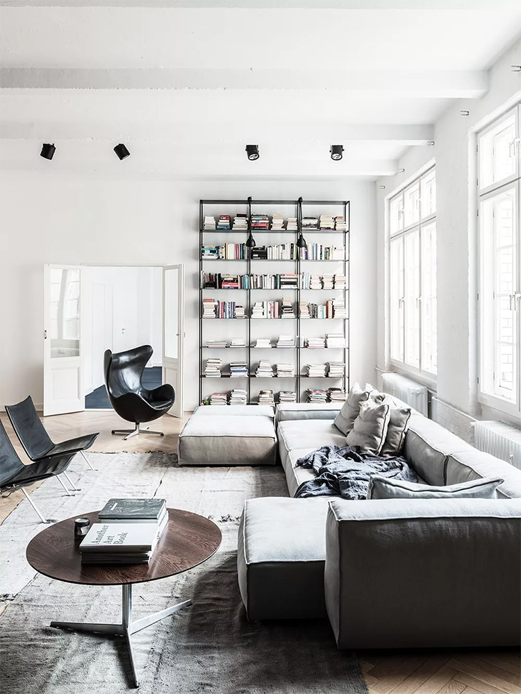 masculine living room book reck and chair